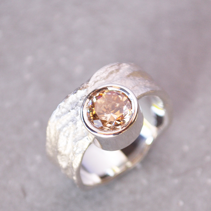 Silver Moringa textured ring with off-center champagne stone.