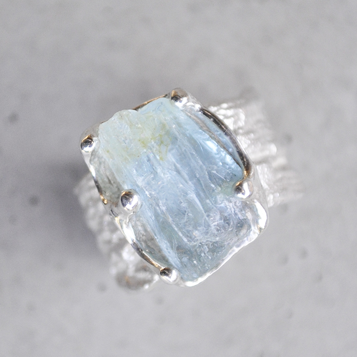 Rough Aquamarine stone set in Moringa textured band