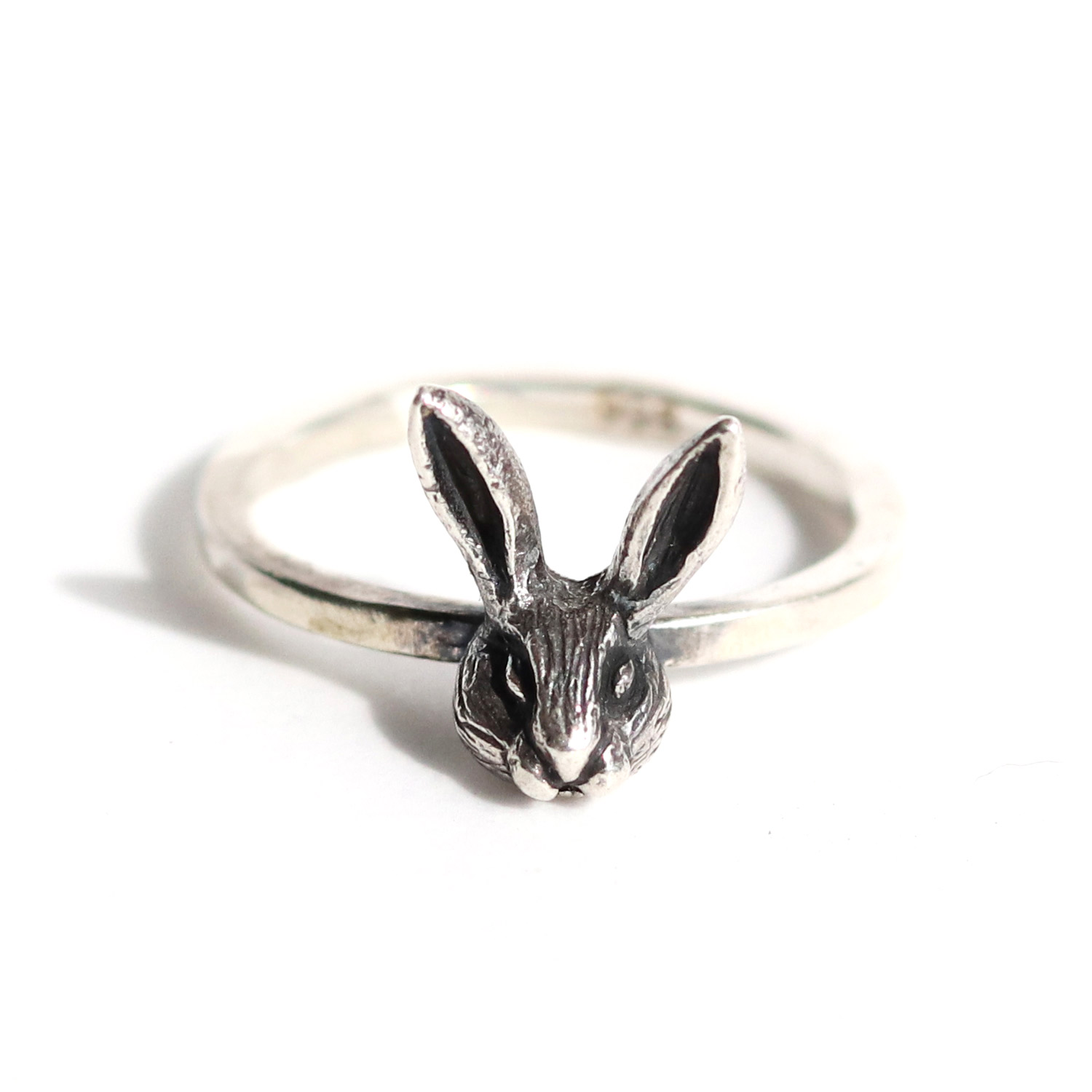 Fudge the rabbit is inspired by my own pet bunny Fudge. The original was painstakingly hand carved from wax to resemble Fudge as closely as possible, then cast into sterling silver.  Thisadorable ringispart of the 'Fudge the Rabbit' Collection, where 10 % goes to The Cape Town Bunny Huggers Foundation (find out more by following this link) https://ctbunnyhuggers.wordpress.com/about/.  Kindly state your ring size (in letter size) in the comment section if you don't find your ring size in the options listed.