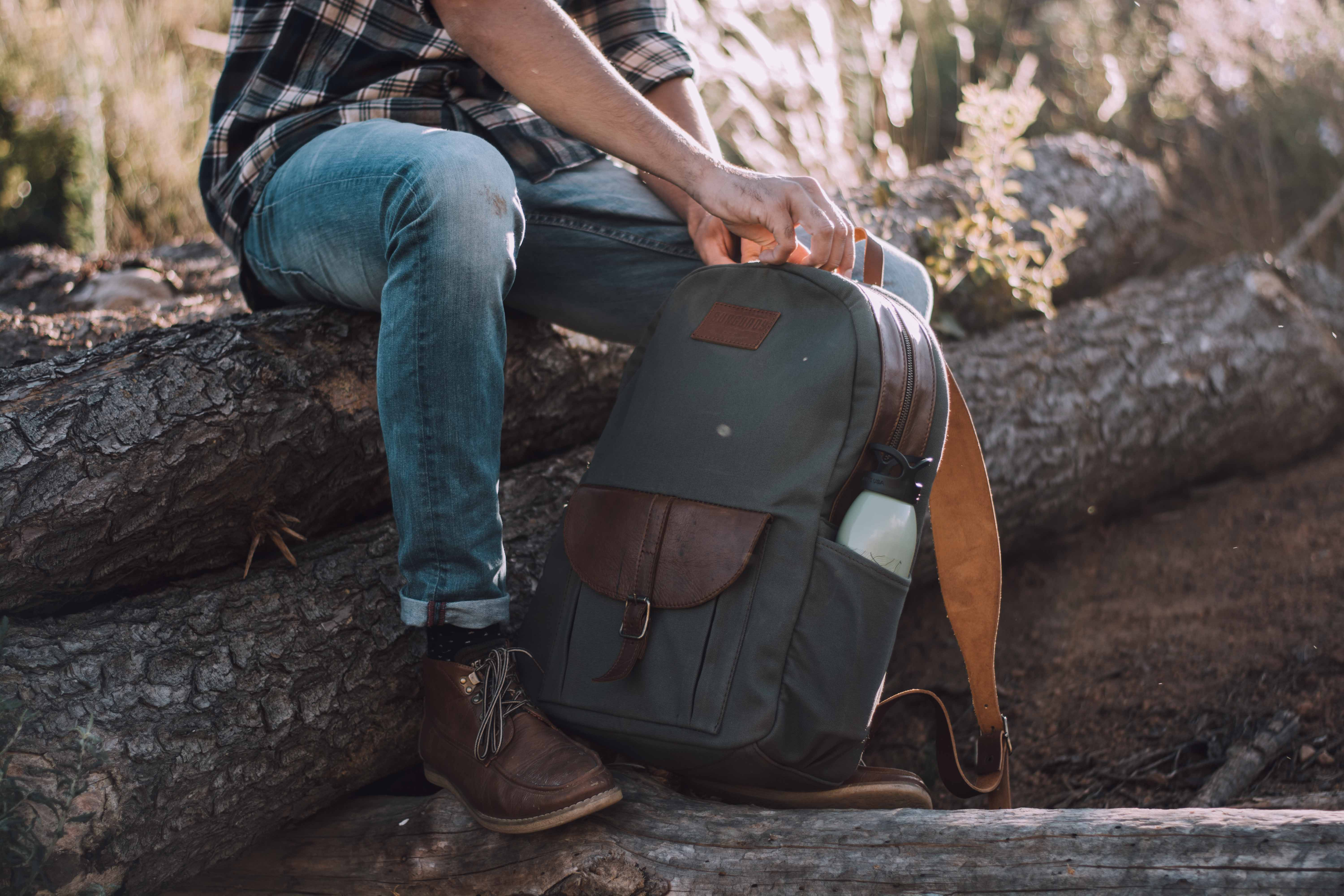 """Perfect traveling companion for the adventurous person. Perfectly designed for any outdoor trips.    FEATURES:   Durable cotton canvas interior & exterior - water repellent Premium vegetable tanned leather straps - 2mm Adjustable back strap system with shoulder pads Secure top zip closure with foam padded back & bottom Fits 15"""" Laptop Back zip pocket with 2x exterior side pockets     DIMENSIONS:  H 42cm x W 30cm x D 13cm"""