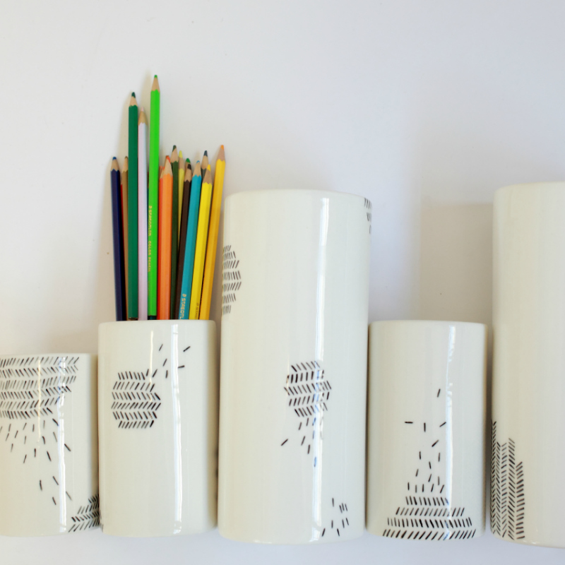 Ideal for flowers, as a make-up brush container or utensil holder. These glossy, multi-use vases are decorated with intricately hand painted scattered lines. Choose your size or better yet, combine them to form a feature.  Approximate dimensions: small 11cm H 6cm dia, medium 14cm H 8cm dia, tall 22cm H 9cm dia.  Materials: glazed stoneware  Microwave safe, hand wash recommended.