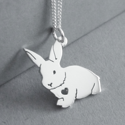 Sterling silver fluffy bunny with heart pendant.