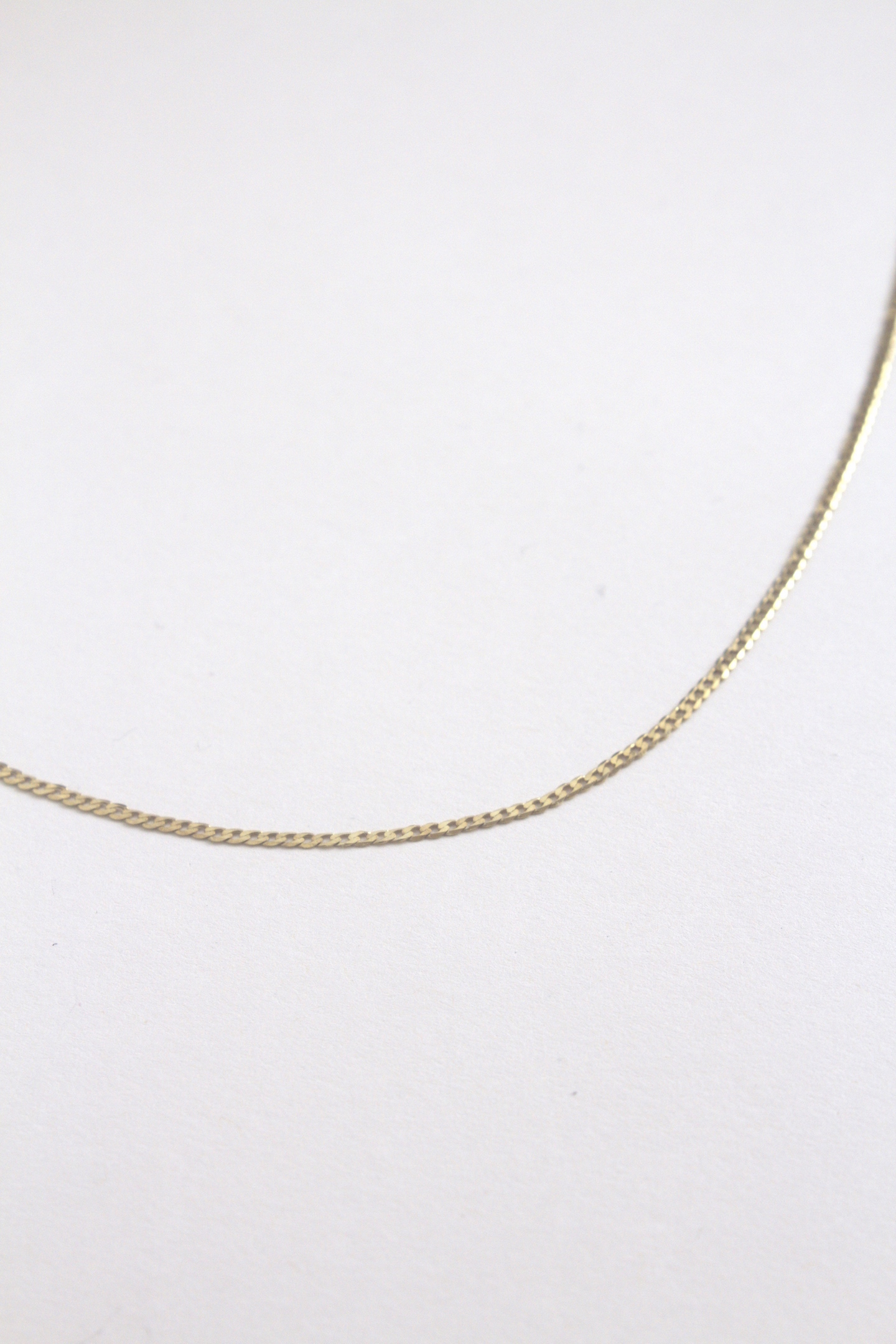 18ct Gold VermeilChain Necklace that could have once belonged to your boyfriend.  This necklaceis a plain gold plated sterling silver chain. Any of our Yellow Jewellery pendants can be added. The longer length is great for layering with our other chains from our collection.  Chain: 50cm length