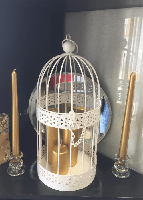 Metal Bird Cage - White - D18cm x H38cm  Pillar Candles:  - 5x8cm - 5x13cm - 5x18cm Metallic Gold, Rose Gold, Silver   Tapered Dinner Candles - H: 30cm D: 2.2cm Metallic Gold, Rose Gold, Silver