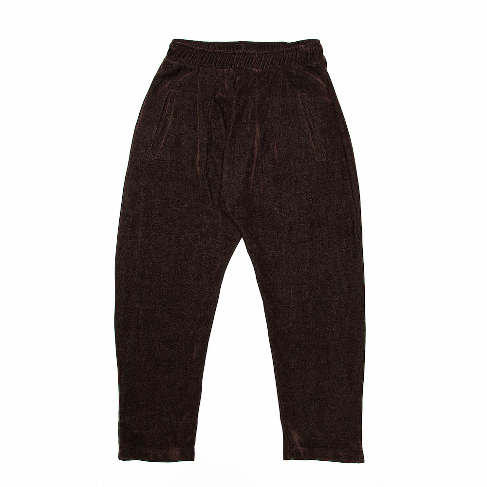 A cropped trouser, finished with deep internal side pockets and a stud button closure back pocket.Cut from a luscious chenille/cotton throw milled in Plettenberg Bay, South Africa.  Handmade in Cape Town.