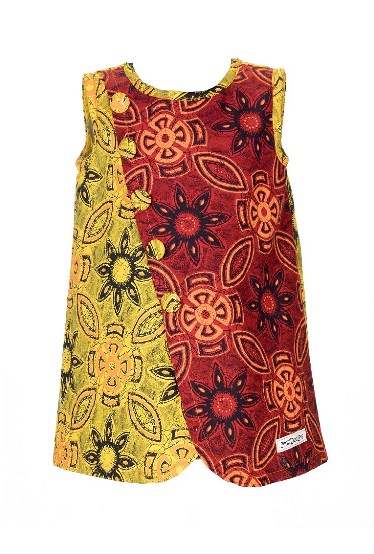 """DESCRIPTION:  Perfect for summer to let the """"wind"""" keep you cool. A knee-length, crossover pinafore with contrasting colour print. Covered buttons diagonally arranged across front creates a special feature. Back fastens with loop and covered button. A cross-seasonal dress - just add leggings and long sleeves for winter.  100% Cotton, ShweShwe. Made in South Africa.  Print detail may vary, but colour options remain as per image.  Refer to product care label for care instructions.  DELIVERY TIME:   Our current completion time to make up your order is1-2 weeks& Shipping will take an additional3-5 working days. You will be notified when you order has been sent."""