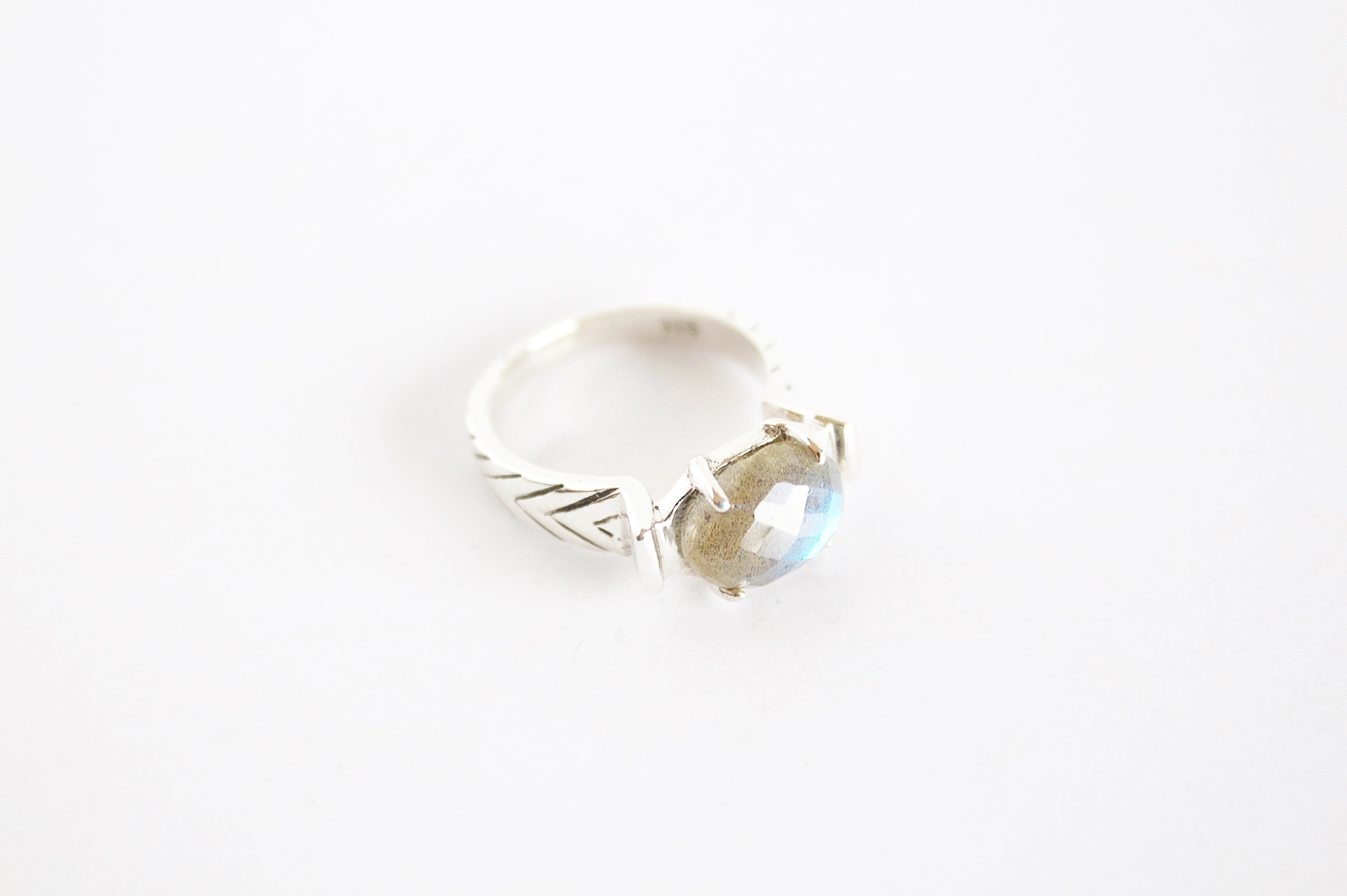 Hand carved ring with line detail on band set with Labradorite