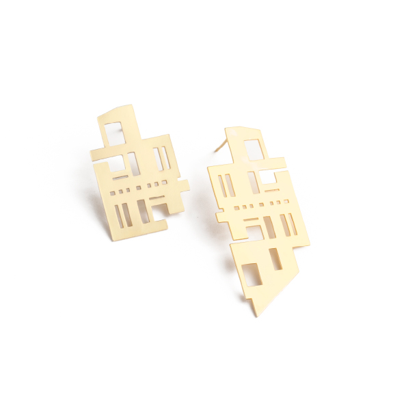 Cape Town streets are lined with buildings from show stopping design feats to functional office blocks and residential spaces. This piece pays homage to the unnoticed buildings, those we walk past daily and have never really seen. The left and right earrings are un-matching, creating the visual cue for them to be noticed. Available in yellow gold plated brass with sterling silver studs. Size: Long piece: 5cm long x 2.2cm wide. Shorter piece:  2.2cm long x 2cm wide
