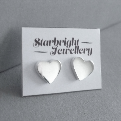 Sterling silver tiny heart stud earrings.