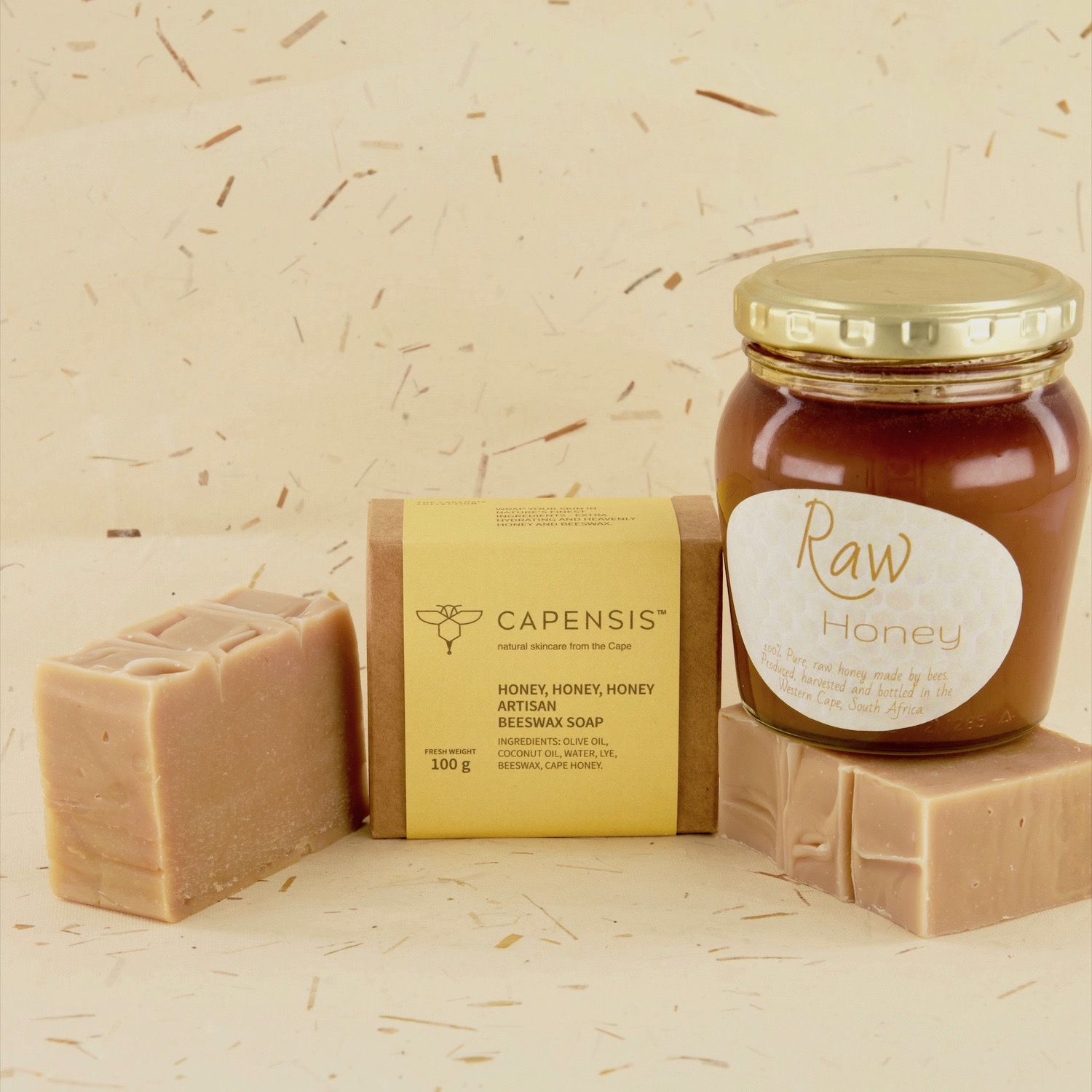 Beeswax & Honey to wrap your skin in nature's finest ingredients. Extra hydrating & heavenly.  Filled with delicious honey which is naturally antibacterial and great for acne treatment and prevention. Honey is full of antioxidants, making it wonderful for slowing down ageing. Honey also helps with a complexion boost: it is extremely moisturising and soothing, so it helps create a honey-glow for your skin. Honey has been known to inhibit growth of bacteria that may affect the skin and cause skin conditions.       100g  Compostable packaging      Capensis artisanal naturalsoaps are handmade in Cape Town, South Africa,with beeswax and honey from the Cape Honeybee.  Beeswax is PROTECTIVE - when applied to the skin, beeswax forms a protective barrier that helps shield your skin from environmental assaults, while also holding in moisture and reducing dryness (but it won't clog your pores). It's a HUMECTANT, helping to keep skin hydrated over time. Beeswax is an excellent source of VITAMIN A - which softens and rehydrate the skin as well as aiding in the healthy development of cellular reconstruction. By acting as a protective, breathable layer on the skin's surface, beeswax helps to lock in moisture for soft, supple, hydrated skin. It also carries antiviral, anti-inflammatory, and antibacterial properties that are essential in fighting chapped and damaged skin as well as acne-prone skin.   Continue shopping - viewall products