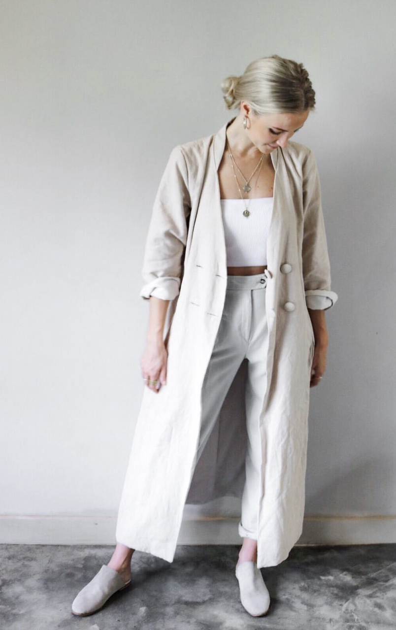 Ramie linen with a poly-cotton lining.  Colour: Stone  Details: The coat has pockets, four fabric covered buttons (one extra button sent with garment) and a single posterior coat vent.  Sizing:  SMALL   Length - 107cm Shoulder to shoulder - 36cm Bust - 81cm Waist - 76cm Hip - 86cm Sleeve length - 53cm Sleeve width - 15cm   MEDIUM   Length - 132cm Shoulder to shoulder - 39cm Bust - 86cm Waist - 76cm Hip - 99cm Sleeve length - 62cm Sleeve width - 18cm   LARGE   Length - 132cm Shoulder to shoulder - 41cm Bust - 91cm Waist - 81cm Hip - 102cm Sleeve length - 62cm Sleeve width - 18cm