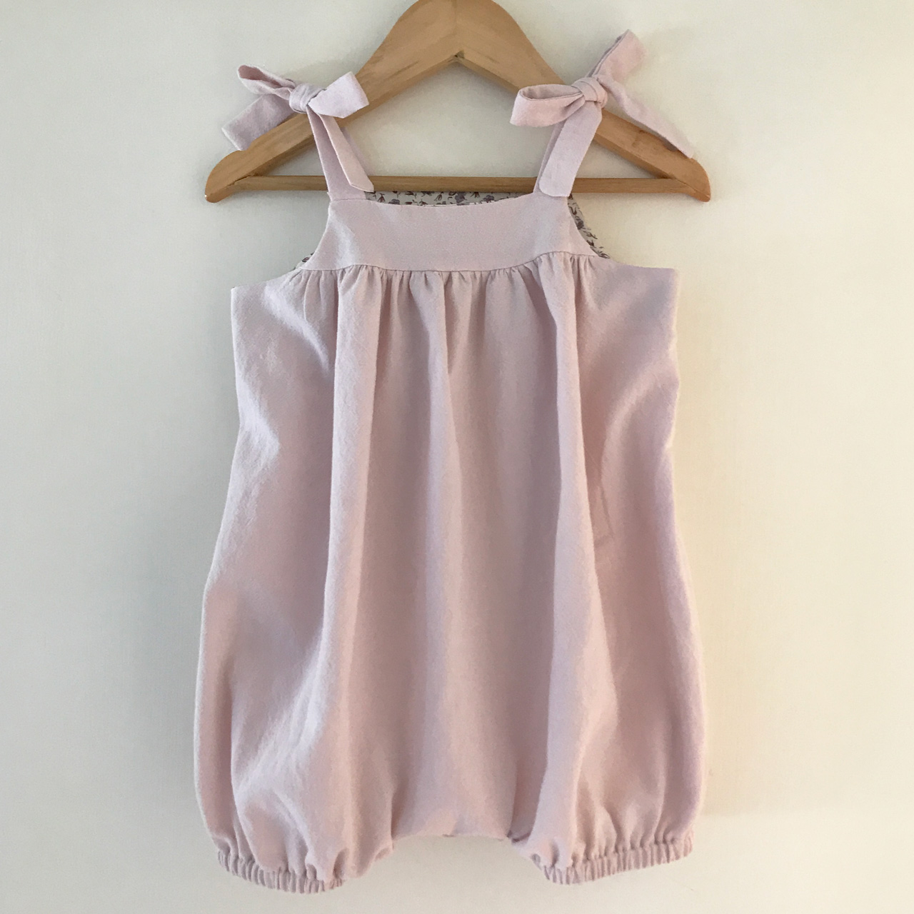 We are in love with our new tie-back vintage baby & toddler romper.  Perfect for those gorgeous spring & summer days.