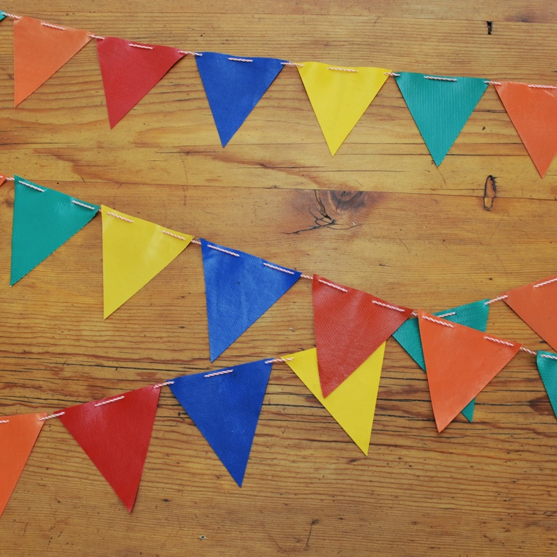 These colourful flags are upcycled from old jumping castle. Each string is about 2m long. The flags themselves measure about10cm long at the point.