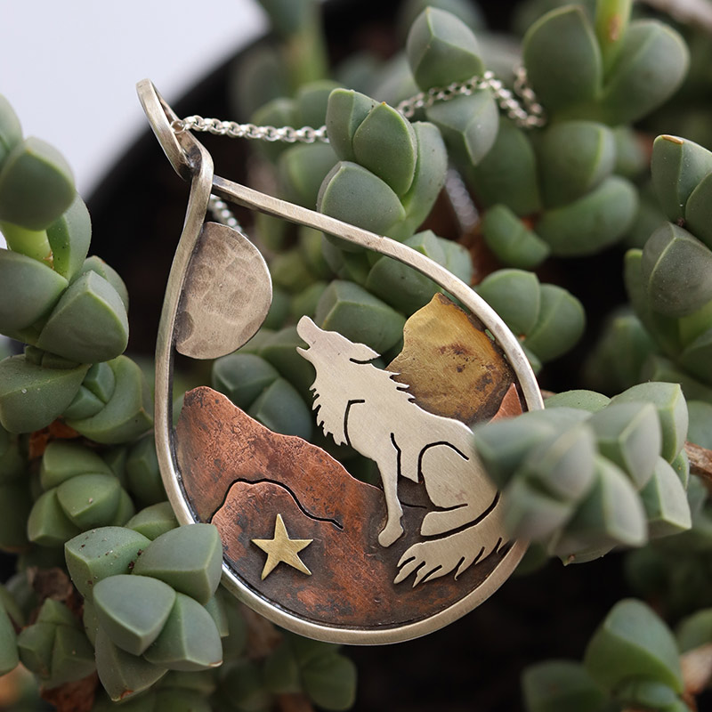 The wolf howling at the moon is the wolf calling to the great spirit to guide him to his true path, to remind himself to follow his instinct. May this piece help guide you to listen to your heart and follow your intuition when in doubt. This piece is hand-drawn and hand-cut from copper, brass and sterling silver to create this one of a kind fairytale.