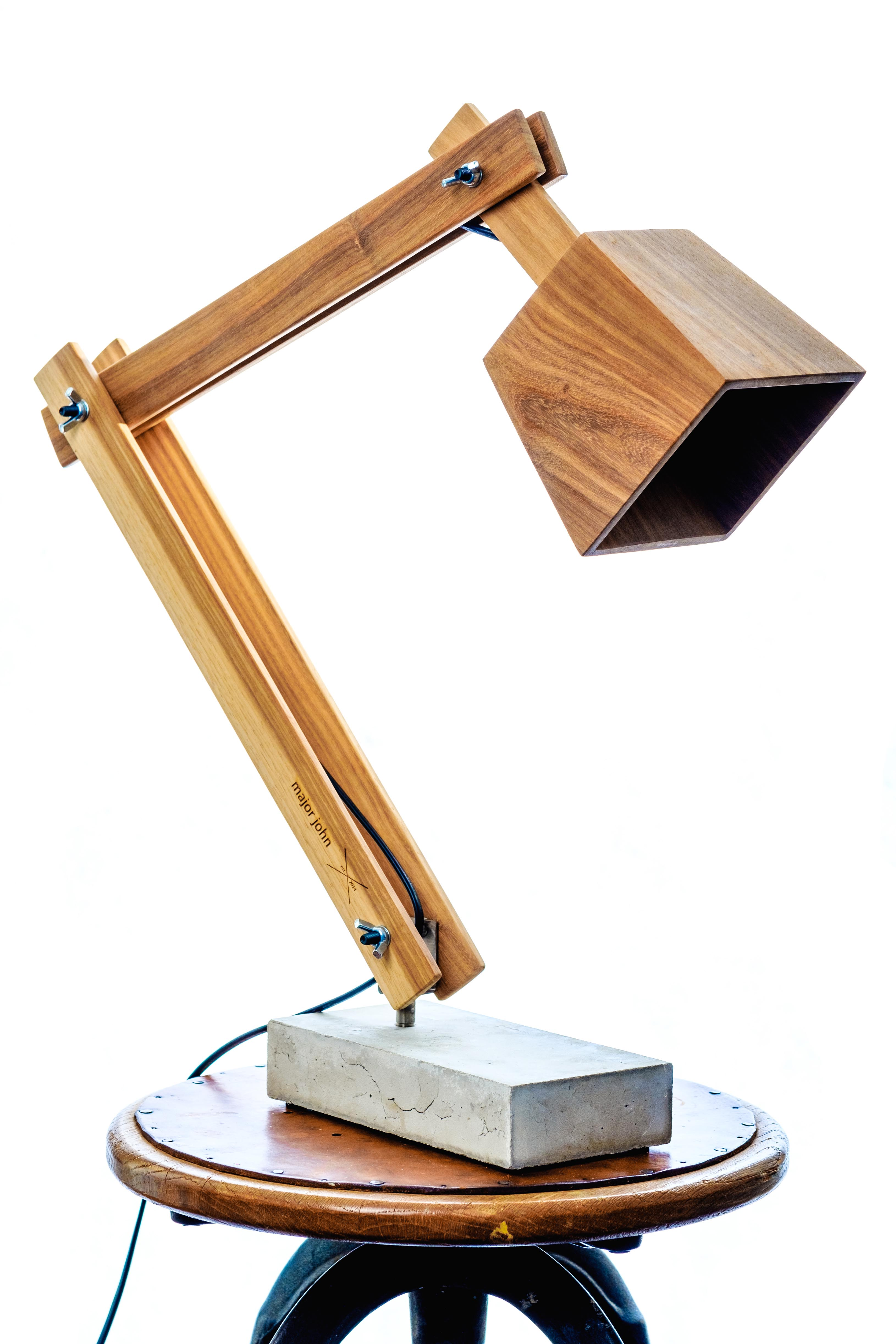 The Desk lamp is made from Namibian Teak timber or American Walnut.