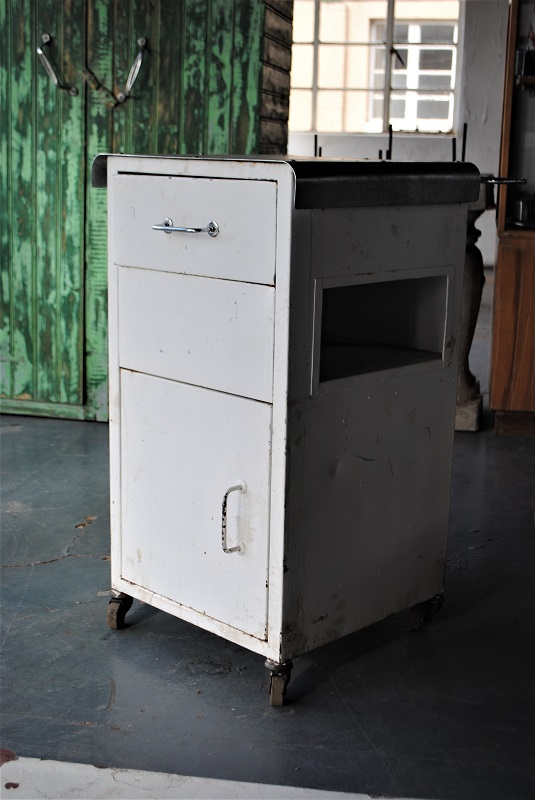 if you are not happy the allocated shipping fee/charge for this purchase or product, please make direct contact with us for a better quote.   This is a charming and very useful bedside trolley, on functioningwheels and small hints of usage/patina - the swing drawer for access from a bed is the winner concept.    This unit stands 83cm tall, 47cm wide and 44cm deep.