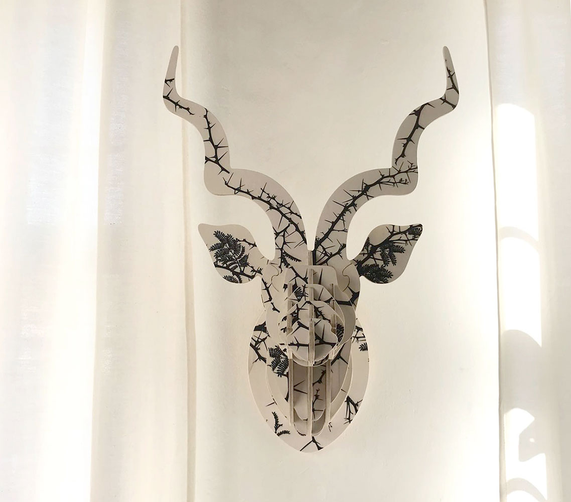 This kudu head is an exciting new series of botanical prints. This print, 'Camel thorn', embodies an iconic African scene of scattered Camel thorn tree branches silhouetted against a bright sunny sky; striking, yet minimalist.