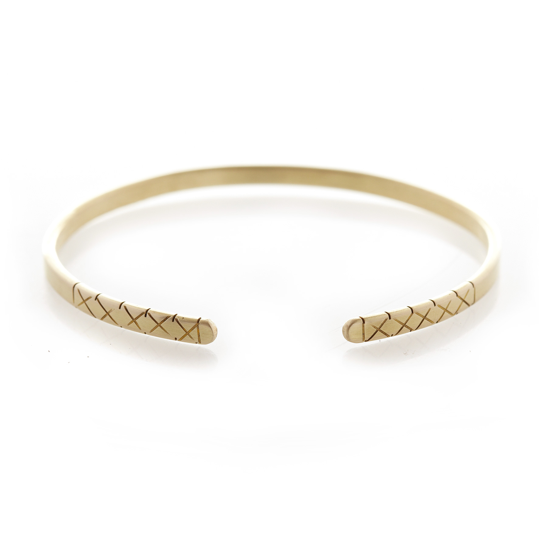 Three quarter X brass bangle