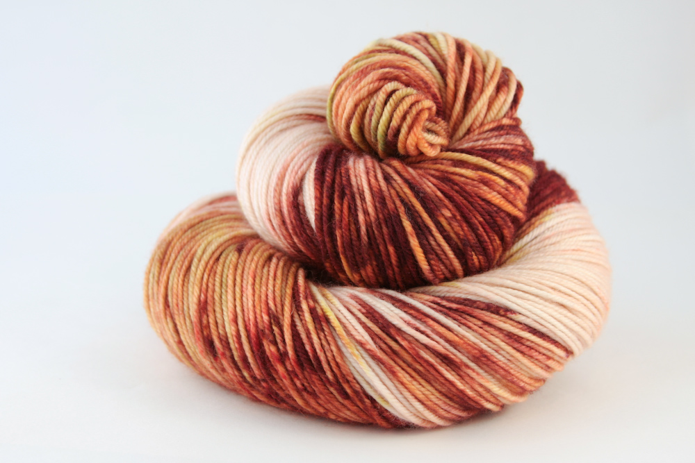 Colour - variegated blush, with splashes of rust, terracotta, saffron, moss, scarlet, emerald  Available in:    Tulbagh DK  80% Fine superwash Merino, 10% Cashmere, 10% Nylon  Double Knit, 100g skeins, 212 metres per 100g.   St Lucia Sock  100% fine superwash Merino, single spun  Sock/4-ply, 100g skeins, 365 metres per 100g.     Hand wash recommended
