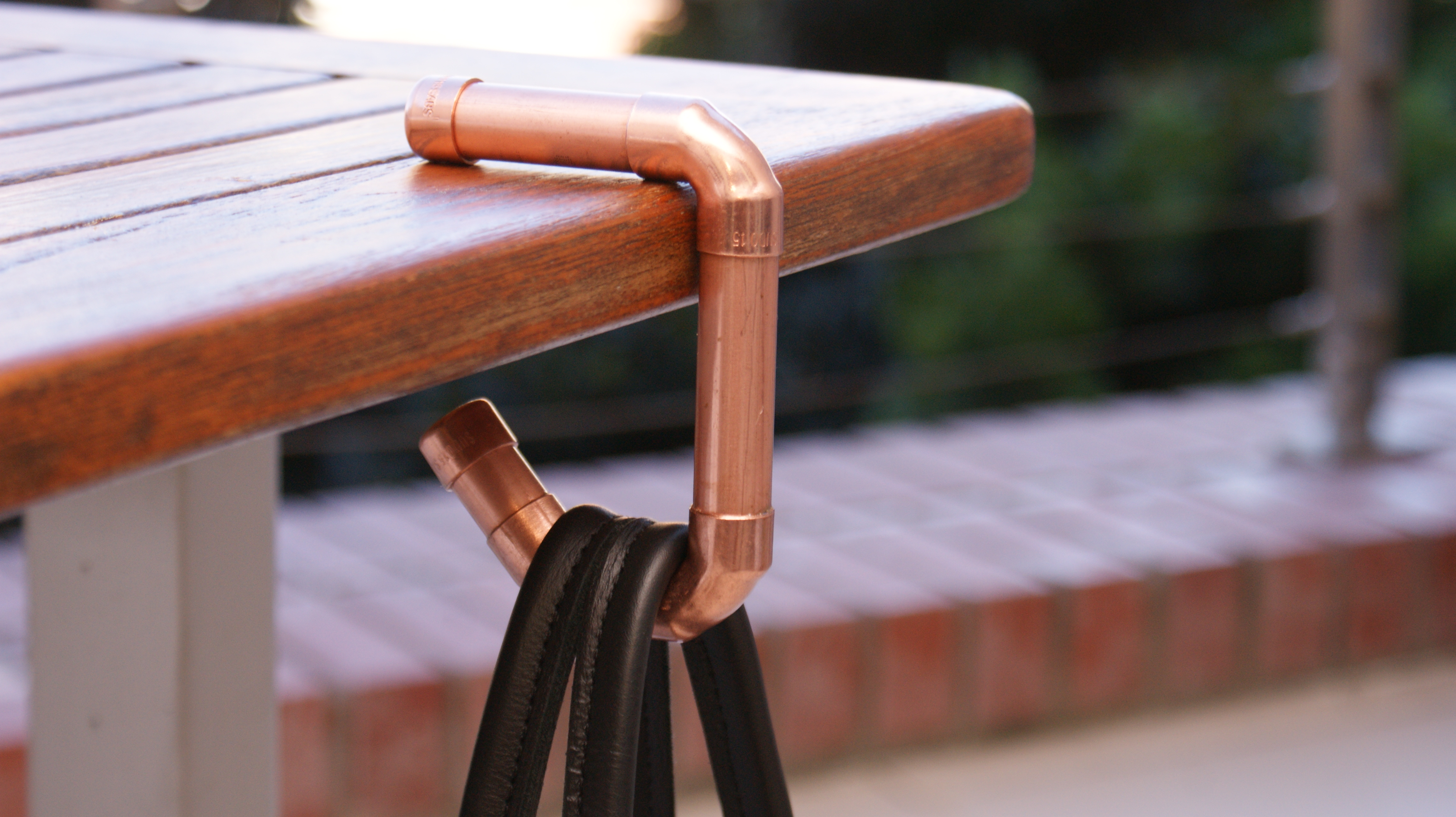 Bespokecopper handbag hook   functional art  - Hand-made by a perfectionist  - Great gift idea  - Material: copper  - Sprayed with anti-tarnish. Polish to restore original shine (as and when needed)