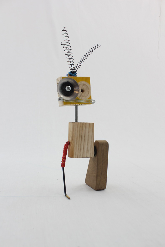 The Rawbot range is a unique collection of quirky characters put together with off cuts of wood, scrap metal, drift wood and other found materials. The idea is to create something of quality with aesthetically interesting features. Each Rawbot is completely unique and various features are moveable. There quirky positive characters become my direct link to them, which I like to see as my passion and happiness being expressed.