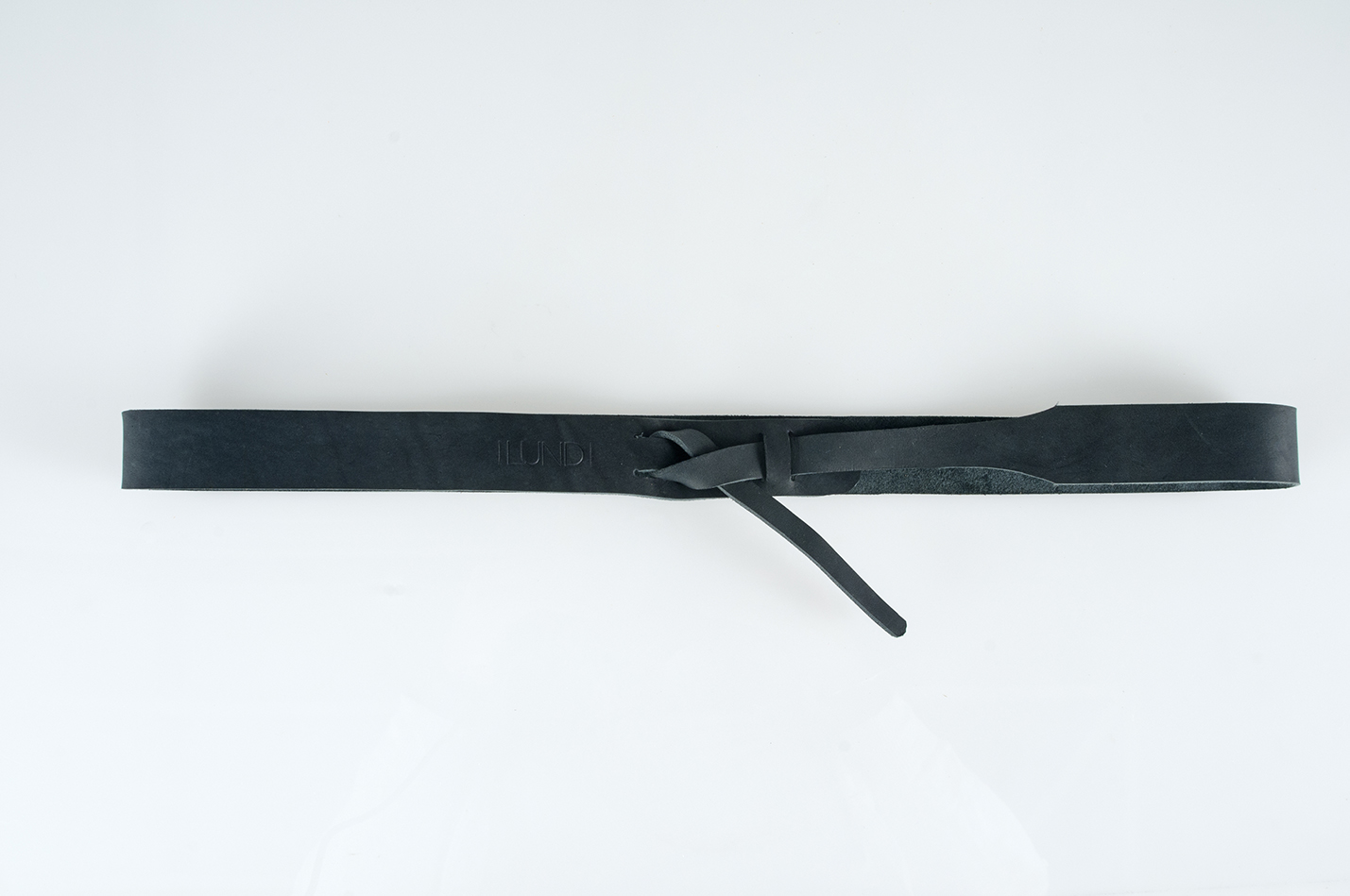 The minimalist design of the Twisted Waist Belt makes it a perfect every-day belt to wear over a dress or loose shirt, or even with jeans. 