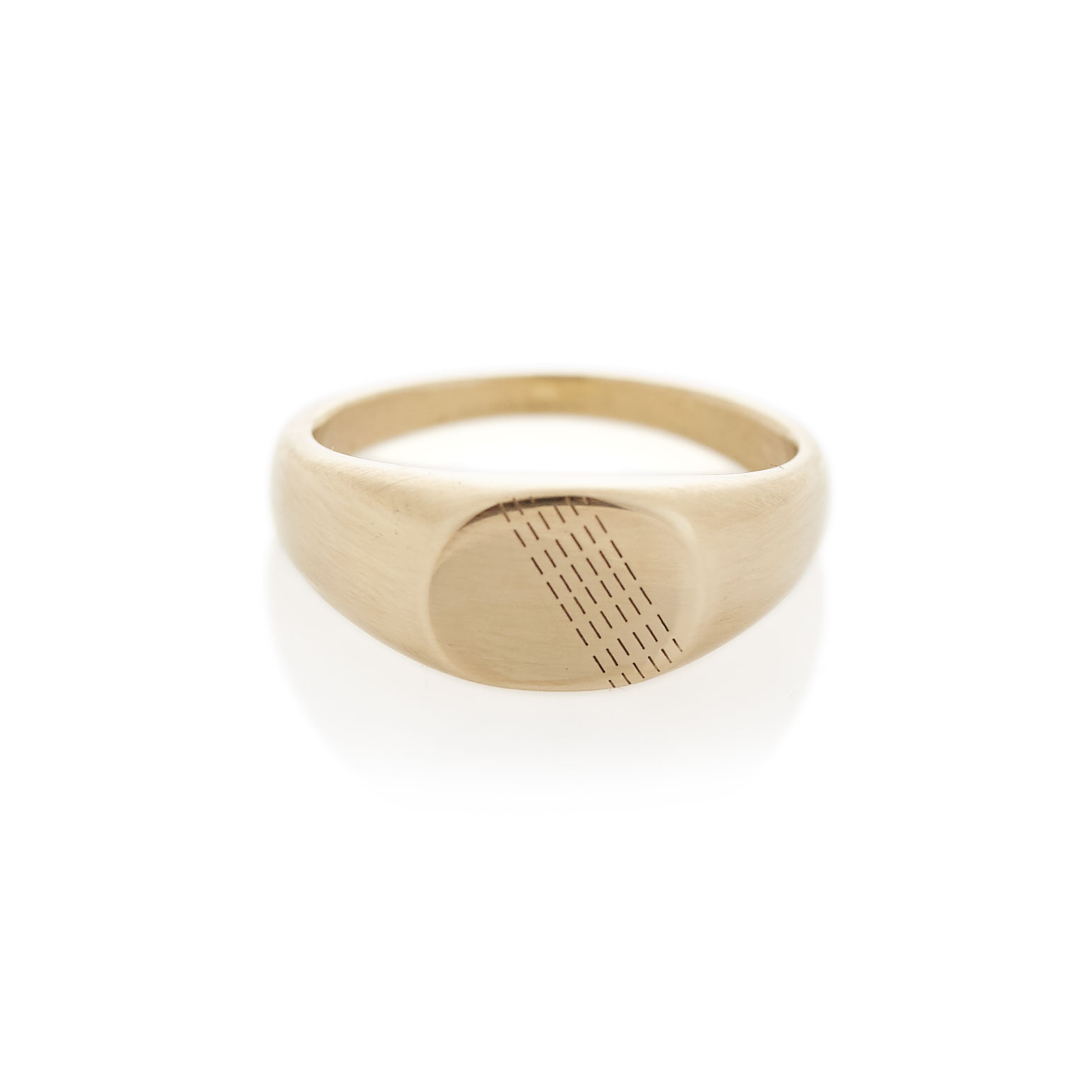 A traditional oval shaped signet ring in solid 9ct yellow gold with diagonal engraved details. The face size is approximately 9mm x 7mm. Available with either a brushed or polished finish. 