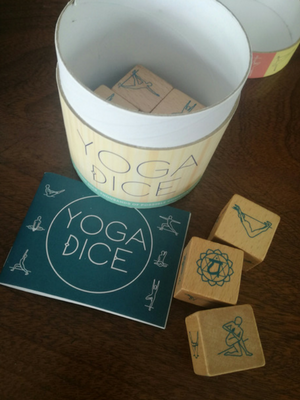 This container of dice holds endless inspiration for every yoga lover! Seven wooden dice (one for each chakra) represent different types of poses—seated, standing, balancing, twists, and more—that, when rolled together in the hand or using the container itself, generate a variety of yoga practices for practitioners of all levels.  This product is only available on PREORDER right now, which means there is a 3 week lead-time for it to arrive. Believe me, it's worth the wait!  No free shipping on this product, but you can collect for free, or order a Yogabox as well for free delivery :)