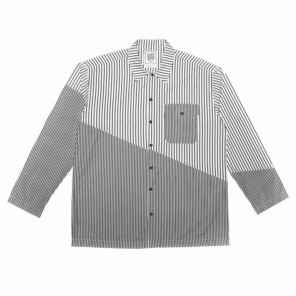A classic box-shaped shirt featuring diagonal split panels and a utility pocket with pen insert. Cut from a lightweight 100% cotton. Finished with a straight hem and hemmed cuffs.  Handmade in Cape Town.
