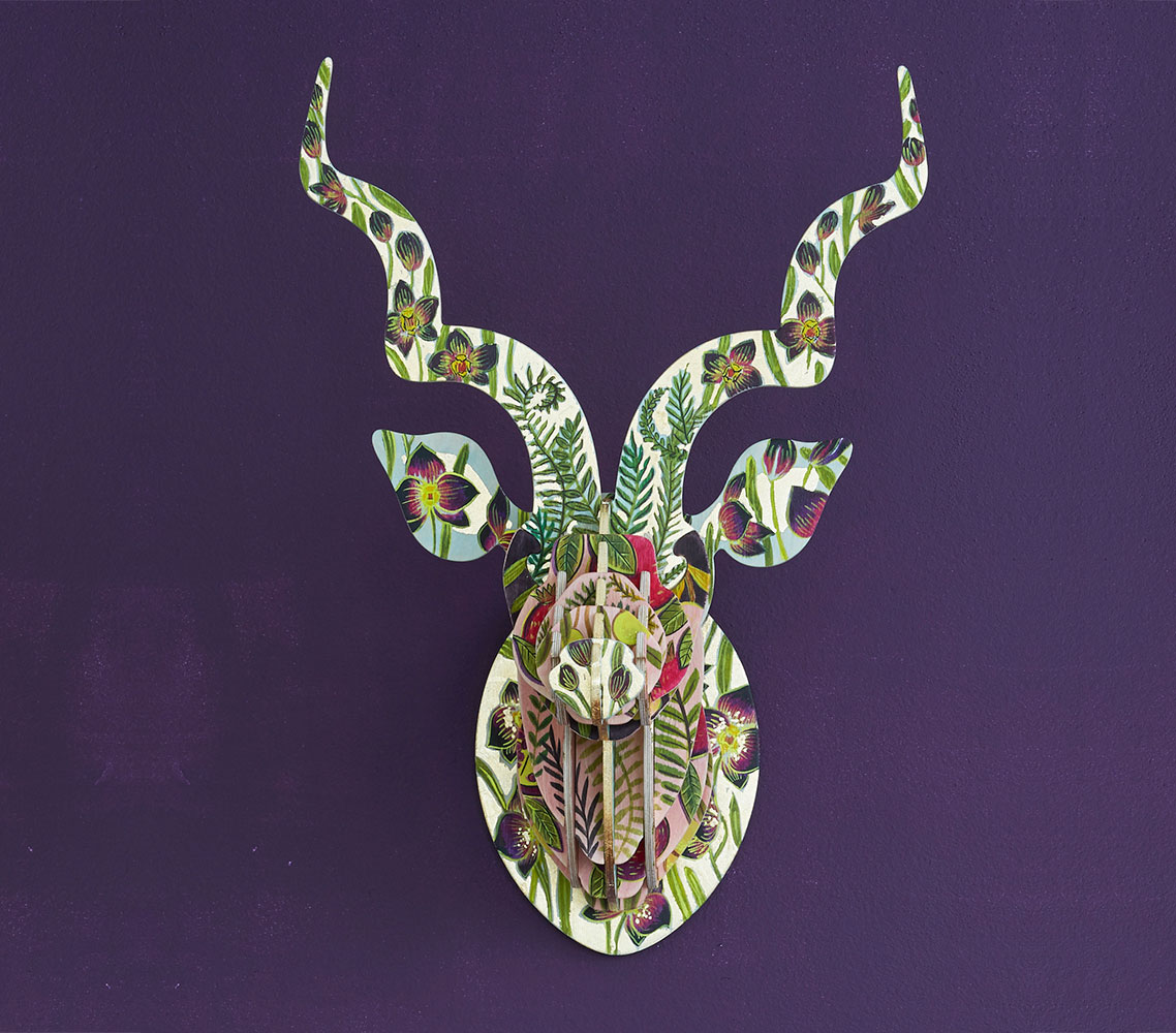 This beautiful Black Orchid Kudu sculpture, painted by Cape Town artist Sharon Boonzaier, is inspired by the deep velvet plum tones of this rare flower which symbolises refined beauty.