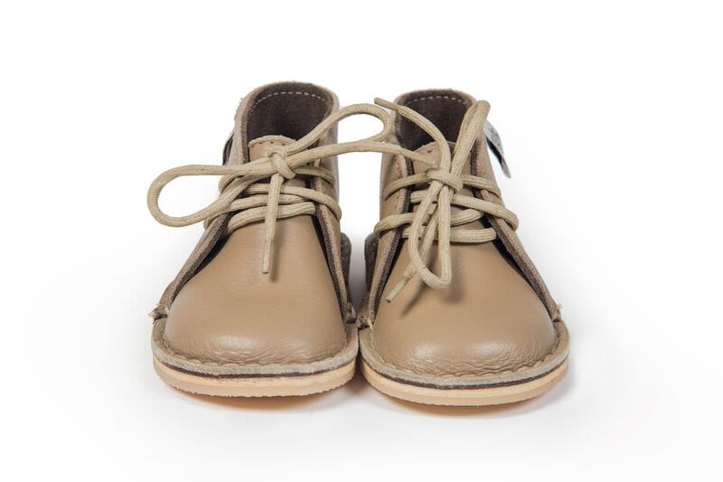 Genuine Leather oxford/vellie styled camel coloured shoe, with easy to tie beige laces . Waterproof and durable rubber sole.
