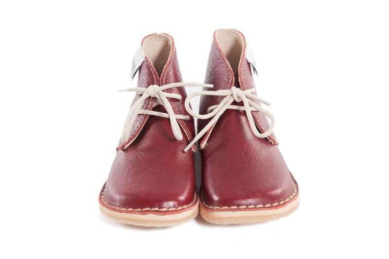 Genuine Leather oxford/vellie styled burgundy coloured shoe, with easy to tie beige laces for the bigger tot. Waterproof and durable rubber sole.