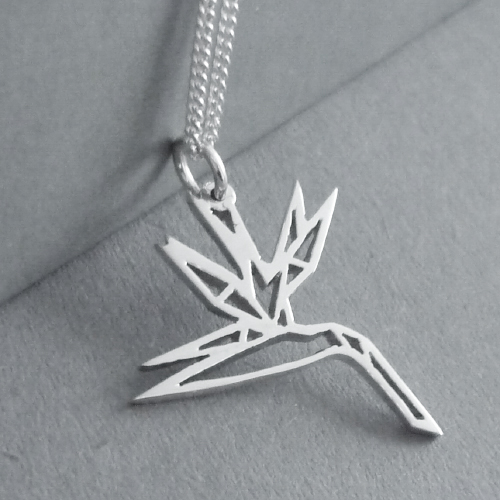 Cute little hand-cut sterling silver strelitzia flowerpendant - inspired by origami design..  This pendant measures approx. 21x23mm in size, andyou have a choice of 45cm or 50cm chains, or no chain :)
