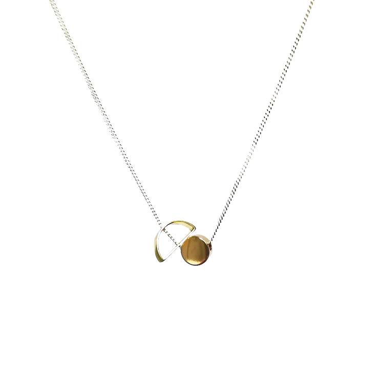 A polished brass solid circle (0.7cm) with a hollow half-moon on a 45cm sterling silver chain.