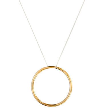 Polished brass circle on sterling silver necklace chain.