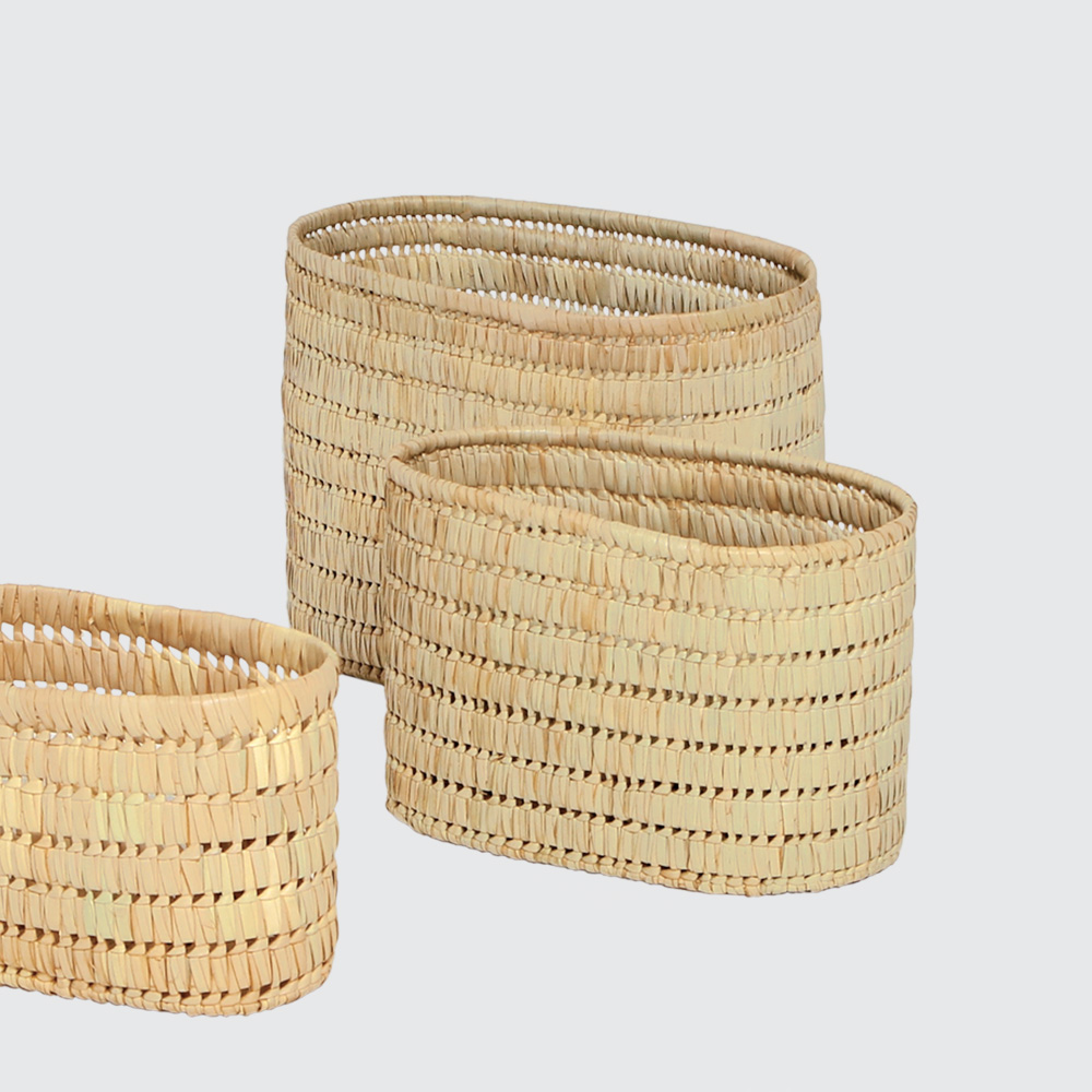 A light basket with a medium weave and an open, airy feel. Great for storing things that need to breathe, like linen.