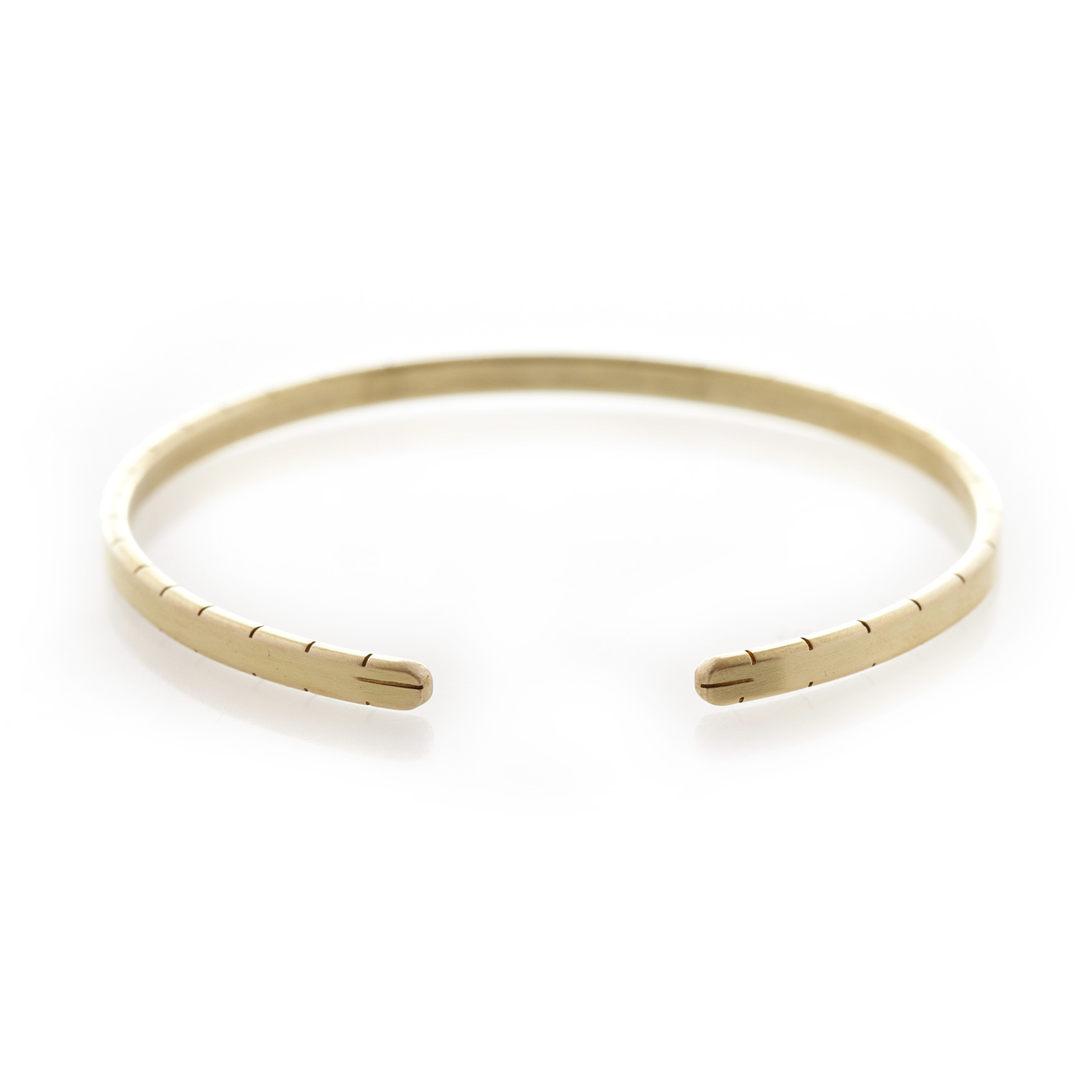 Three Quarter striped edge brass bangle