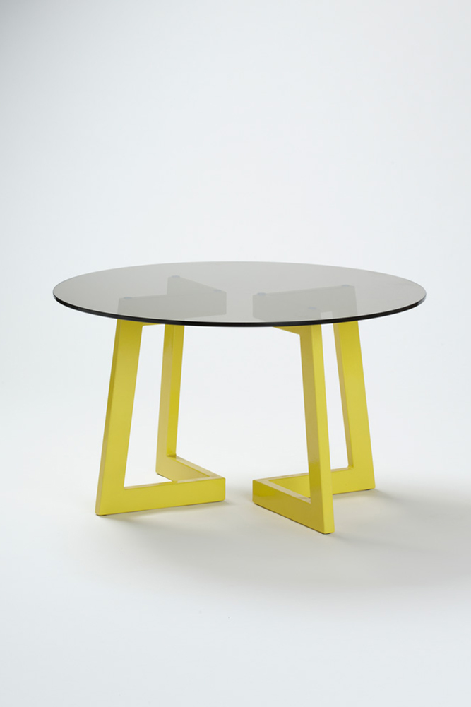 A subtle black tinted glass top creates an eye-catching contrast to the yellow leg structure. The epoxy coated leg structure can be configured in multitude of various ways, allowing the user to become apart of the final design and configuration.