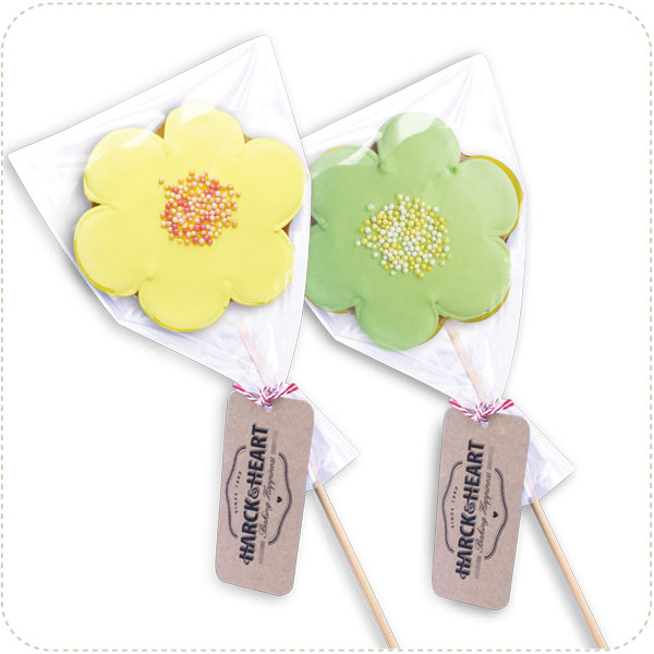 Big, bight and beautifully decorated flowers on sticks
