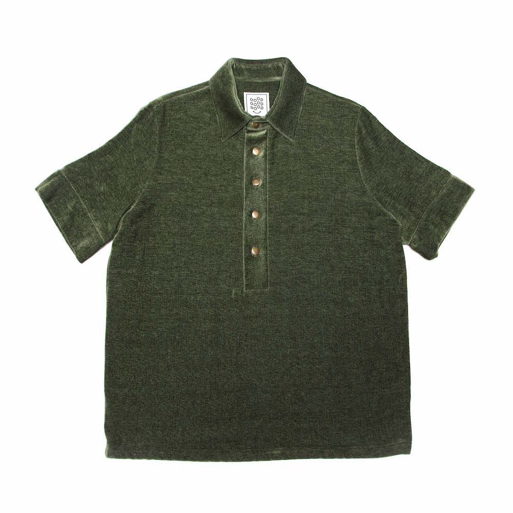 A classic box-shaped polo shirt. Finished with a straight hem and antique brassbuttons. Cut from a luscious chenille/cotton throw milled in Plettenberg Bay, South Africa.  Handmade in Cape Town.