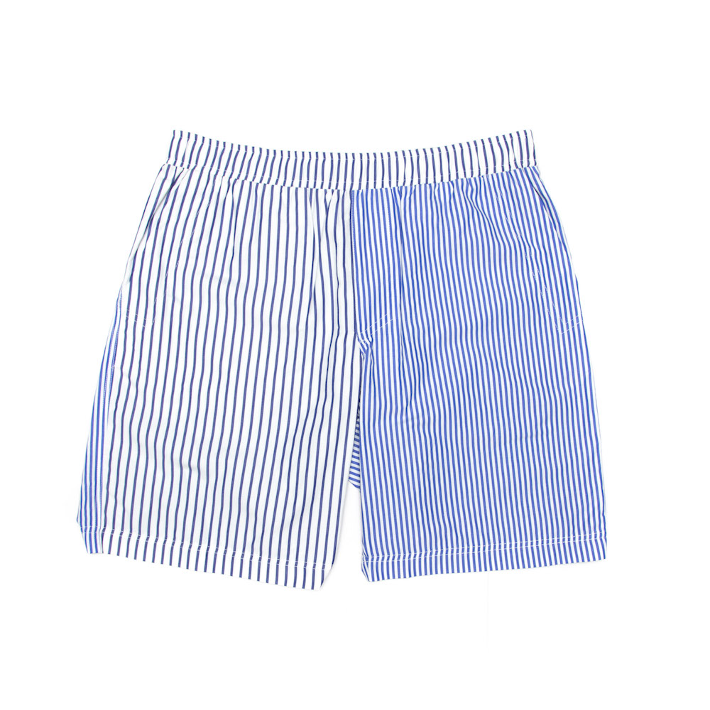 Classic leisure short cut from a lightweight 100% cotton, featuring irregular striped panels. Finished with deep side pockets,a hidden back zip pocket and an elasticated drawstring waistband.