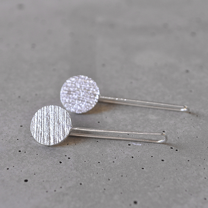 These light weight subtle Jennas have a 10mm coco textured disc face. Their drop is around 20mm.