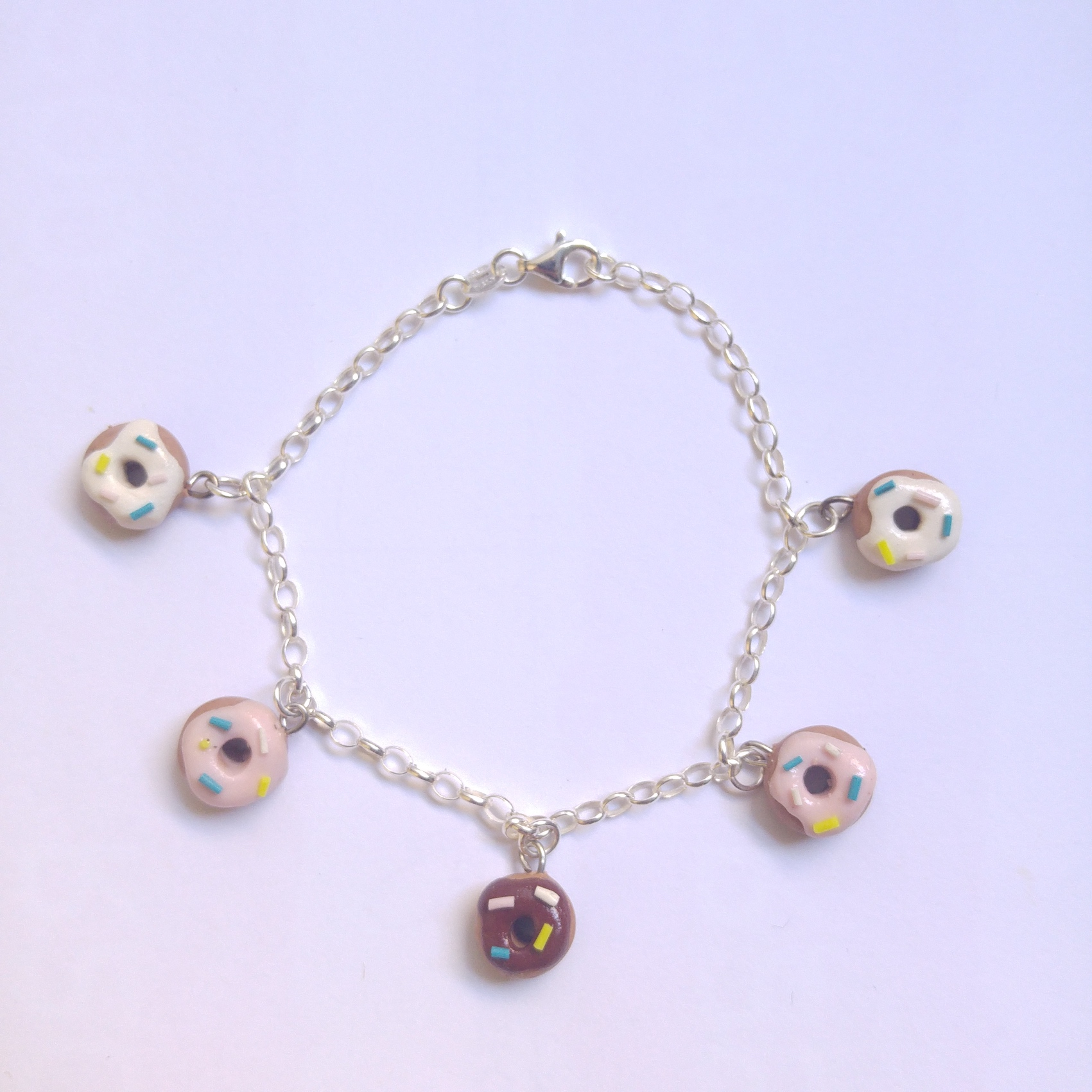 Pink, white and chocolate 'iced' donut polymer clay bracelet with sprinkles of various colours.