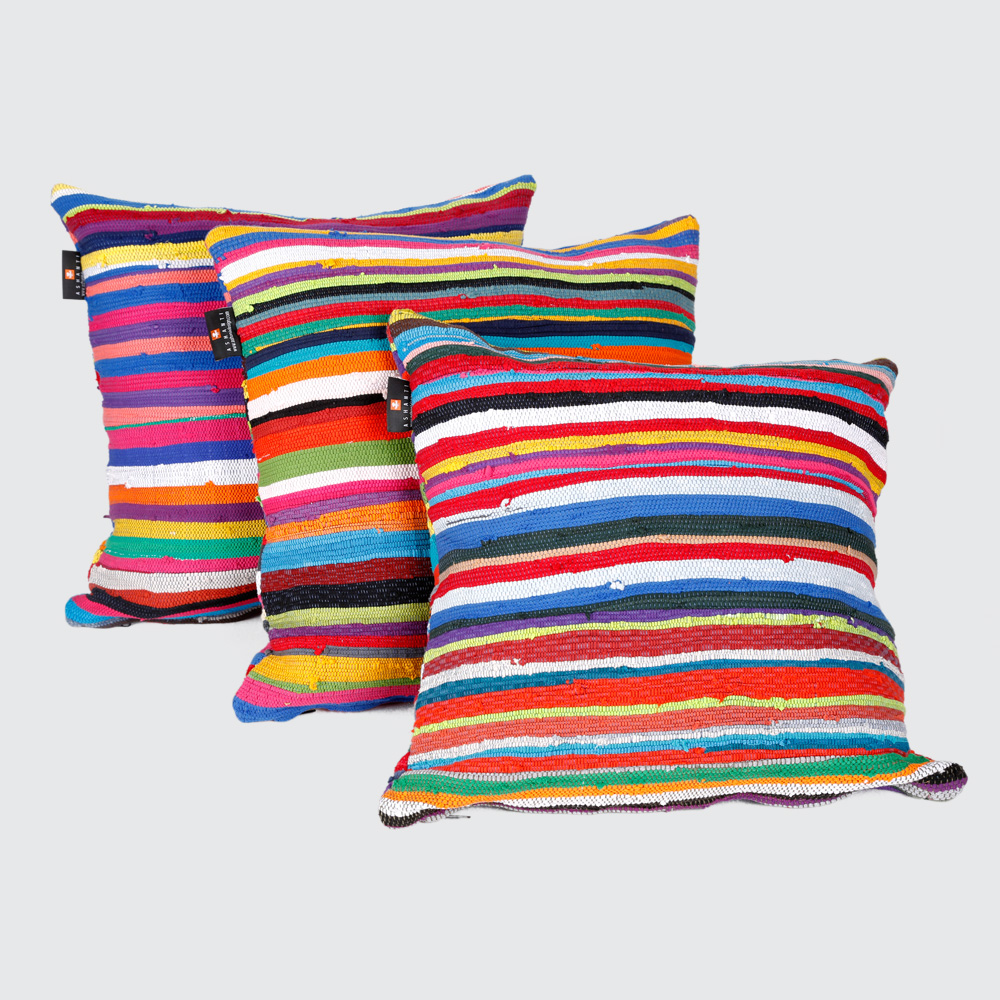 Brighten your work, play, or rest space with our Pumla scatter cushions, quilted from strips of our signature fabric. Made with different colour combinations on either side – have fun flipping your Pumlas to suit your vibe. Available with a quality upcycled inner cushion, or flatpacked as the cover only.