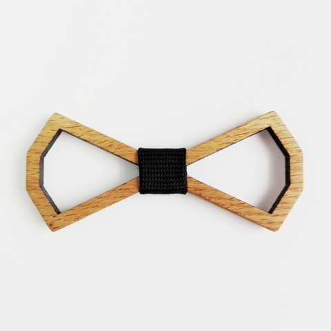 """Dizaine is french for """"about 10"""". However you count the facets this bowtie is a real Beaut. One of our first ever designs and re-released for 2018. The Crisp clean lines say it all. Available in Oak (as pictured) And now loaded into our Óriginal Gentlemans box."""