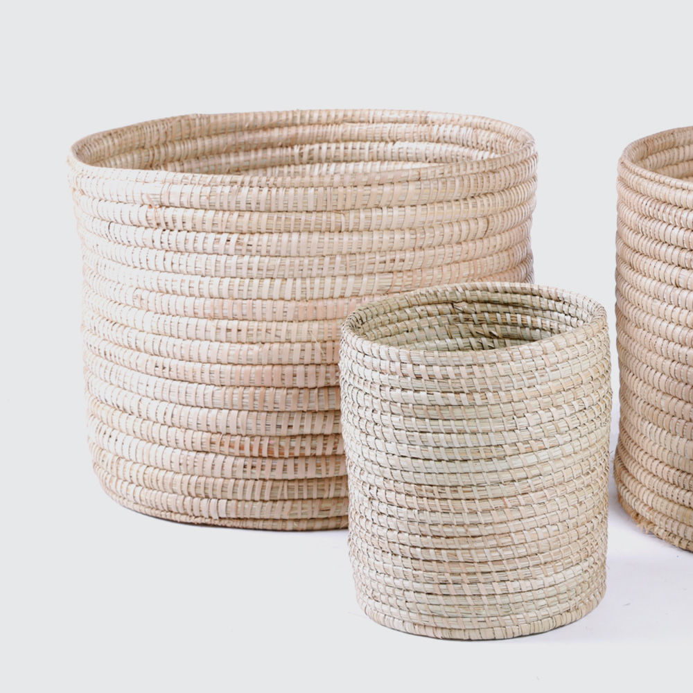 A strong, sturdy round basket woven from Palm. Great for storing anything from magazines in the small size to firewood in the large size.