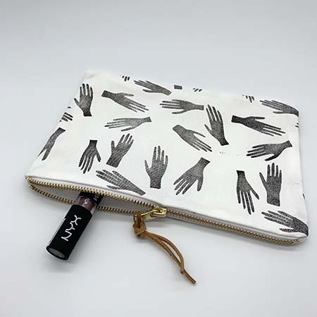 The high five clutch is a gorgeous handcrafted addition to your wardrobe. It features hand block printed cotton with a gold zip and genuine leather tag to add some sparkle and natural feel to your day or night.