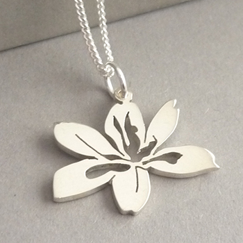 Cute little hand-cut Sterling silver African Iris pendant..