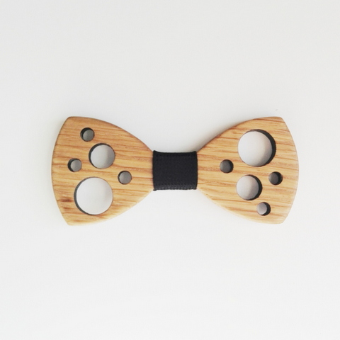 Our excentric swiss cheese look-a-like.  The Holey Moley is fresh and funky.  Available in light or mid toned wood with either a black or navy centre ribbon