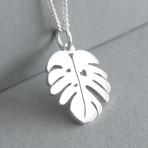 This is a dainty little Delicious Monster Leaf Pendant - cut by hand, and measuring approx. 14x17mm in size.